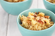 Bowls of cooked quinoa with pecans or walnuts and apples.